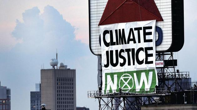 File photo: Banner reads 'Climate Justice Now' on the iconic Citgo sign near Fenway Park in Kenmore Square, Boston, US.(AP)