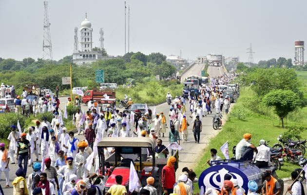 Farmers blocking the Beas bridge during a protest at Beas in Amritsar district on Monday.