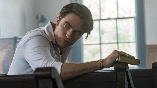 The Devil All the Time movie review: Robert Pattinson as Preston Teagardin in a still from the new Netflix film.(Glen Wilson/Netflix)