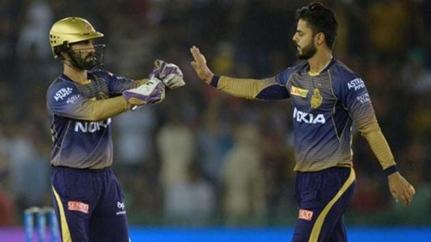Nitish Rana celebrates a wicket with his KKR captain Dinesh Karthik(Getty Images)