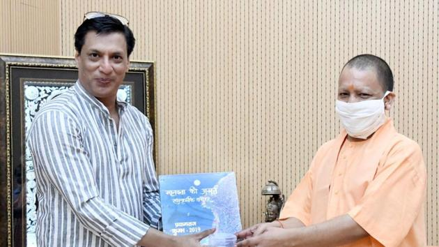 The CM gifted Bhandarkar a coin with Lord Ram's inscription on it; a copy of the RamCharitmanas, an epic poem in the Awadhi language that was composed by the 16th-century bhakti poet Goswami Tulsidas.(Sourced)