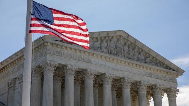 A US flag flies at half-staff during a vigil for Supreme Court Justice Ruth Bader Ginsburg outside the Supreme Court in Washington, DC, on Sept. 19.(Bloomberg)