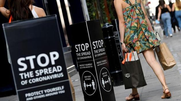 hoppers walk past social distancing signs at the Covent Garden shopping and dining district, amid the spread of the coronavirus disease in London, Britainhoto(Reuters file)