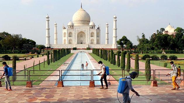 Uttar Pradesh, Sept 20 (ANI): Workers spray disinfection at Taj Mahal premises as Taj Mahal reopens from Sep 21, in Agra on Sunday. (ANI Photo)(ANI)