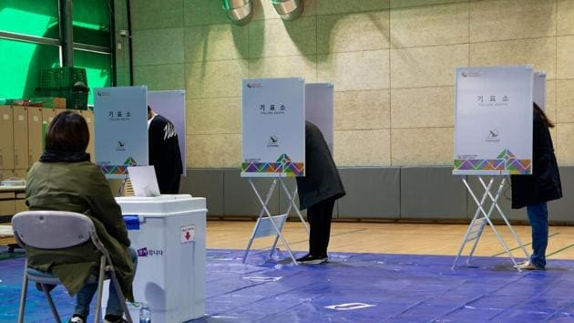 Voters mark their ballots during parliamentary elections in Seoul, South Korea in April.(Bloomberg)