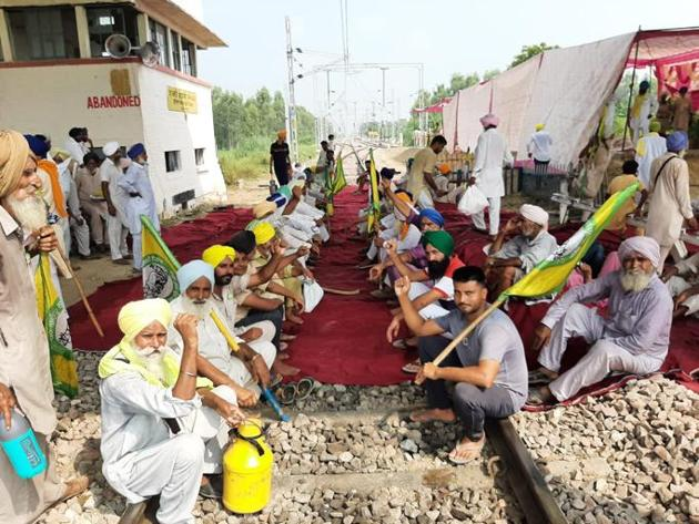 Farmers holding a protest on a rail track in Punjab's Sangrur district on Thursday.(HT Photo)