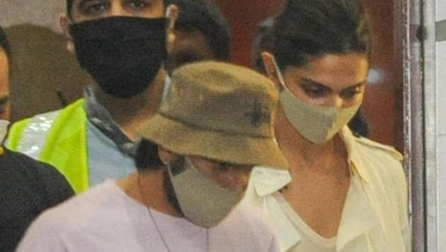 Bollywood actors Deepika Padukone and Ranveer Singh arrive at Mumbai International Airport, after the former was summoned by NCB in a Bollywood drugs probe.(PTI)