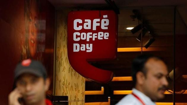 Men stand outside a Cafe Coffee Day outlet in New Delhi, India.(REUTERS)