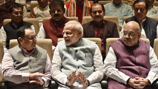 Prime Minister Narendra Modi, Union Home Minister Amit Shah and BJP National President JP Nadda.(Sanjeev Verma/HT PHOTO)