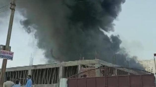 A under construction building in Kasna, Greater Noida catches fire.(ANI/Twitter)