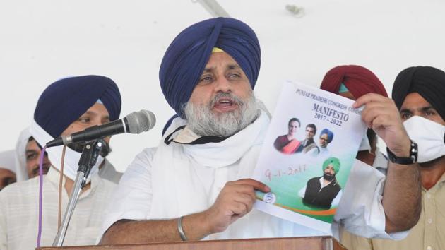 Shiromani Akali Dal (SAD) president Sukhbir Singh Badal shows the Congress party manifesto while addressing party workers at Gurdwara Bhadurgarh Sahib, in Patiala, Punjab, India, on Saturday.(Bharat Bhushan/HT Photo)