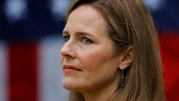 US Court of Appeals for the Seventh Circuit Judge Amy Coney Barrett looks on as US president Donald Trump announced her as his nominee to fill the Supreme Court seat left vacant by the death of Justice Ruth Bader Ginsburg, who died on September 18.(Reuters Photo)