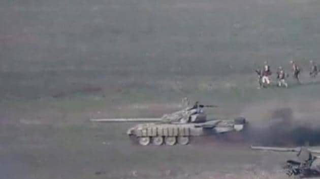A still image from a video released by the Armenian Defence Ministry shows what is said to be Azerbaijani tanks and service members during at attack in the breakaway region of Nagorno-Karabakh, in this still image from footage released September 27, 2020.(via REUTERS)