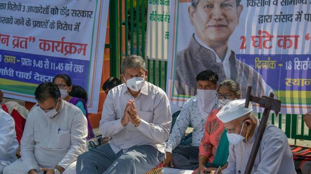 In this file photo from Sept. 18, 2020, Congress General Secretary Harish Rawat along with party workers keeps a two-hour silent fast during a protest over agriculture related ordinances, in Dehradun.(PTI)