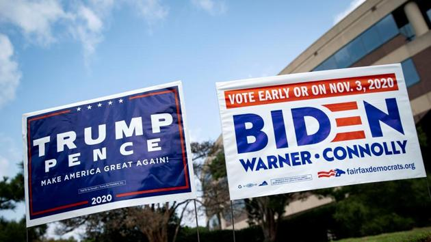 Yard signs supporting US President Donald Trump and Democratic U.S. presidential nominee and former Vice President Joe Biden are seen outside of an early voting site at the Fairfax County Government Center in Fairfax, Virginia.(REUTERS)