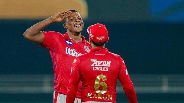 Dubai: Kings XI Punjab player Sheldon Cottrell reacts after taking the wicket of Delhi Capitals player Axar Patel during the cricket match of IPL 2020.(PTI)