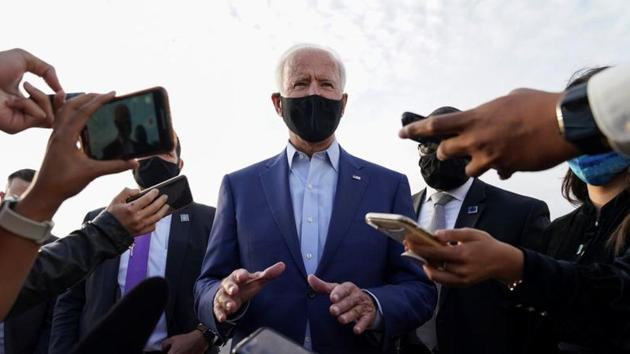 US Democratic presidential candidate Joe Biden speaks to reporters upon his departure after campaigning in Charlotte, North Carolina.(REUTERS)