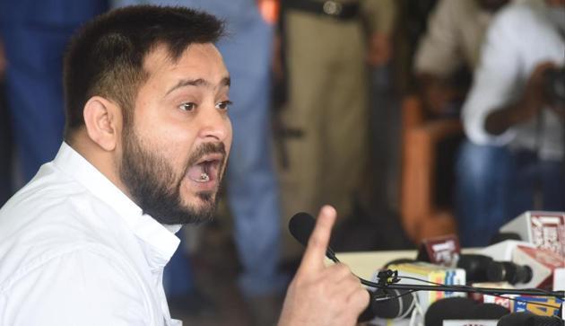 RJD leader Tejashwi Yadav addressing a press conference at the party office in Patna on Sunday.(Santosh Kumar//HT PHOTO)
