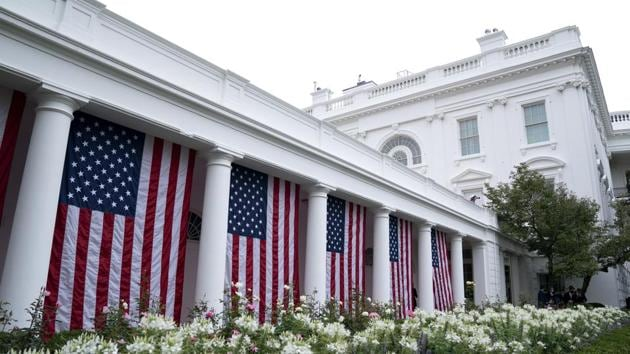 American flags are displayed in the Rose Garden ahead of the announcement of US President Donald Trump's nominee for associate justice of the U.S. Supreme Court during a ceremony at the White House in Washington.(Bloomberg)