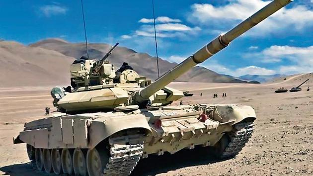 Indian army soldiers operate a T-90 Bhishma tank near the Line of Actual Control in the Chumar-Demchok area of Eastern Ladakh on Sunday.(ANI Photo)