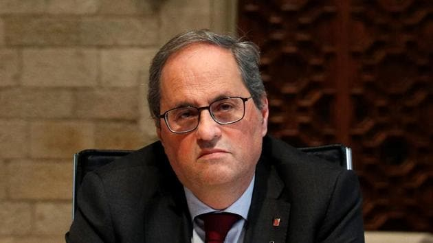 Torra, who has in the past encouraged acts of civil disobedience in response to Spanish judicial rulings, didn't immediately react to the ruling.(Reuters Photo)