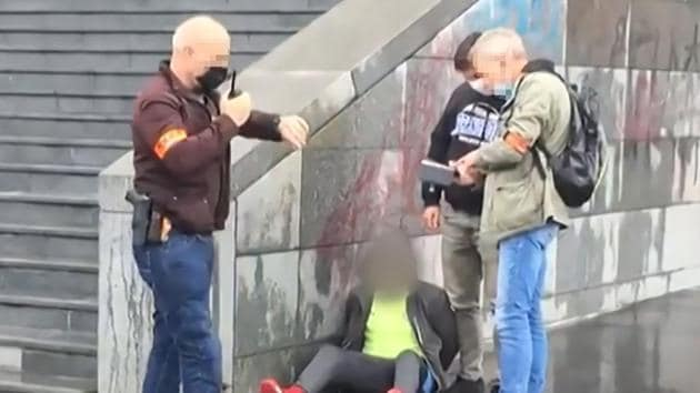 This grab taken from a video obtained by AFP shows French police detaining an alleged suspect after several people were injured near the former offices of the French satirical magazine Charlie Hebdo following an attack by a man wielding a knife in Paris on September 25, 2020.(AFP)