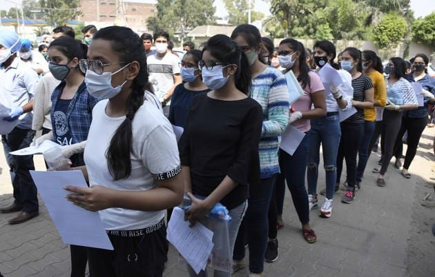 CLAT candidates outside the examination centre at Sherpur Chowk in Ludhiana on Monday.(Harsimar Pal SIngh/HT)