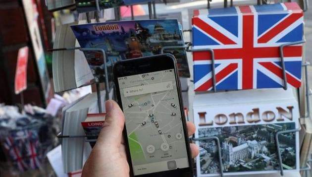 A photo illustration shows the Uber app and London themed postcards in London.(Reuters file)