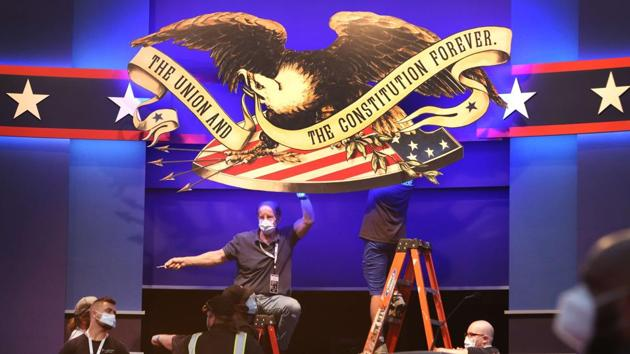 Workers prepare the stage for the first presidential debate between U.S. President Donald Trump and Democratic presidential nominee Joe Biden at Case Western Reserve University and the Cleveland Clinic on September 28 in Cleveland, Ohio.(AFP)