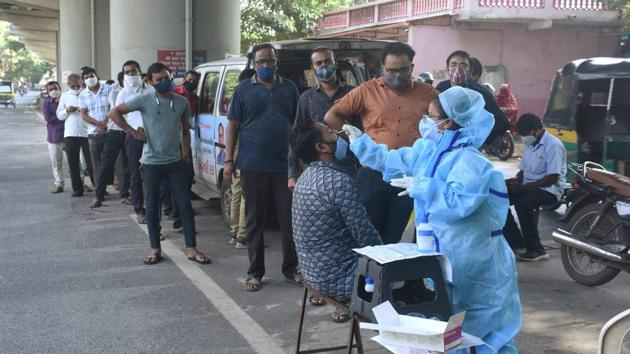 Surat: People queue up to give samples for COVID-19 tests, in Surat, Tuesday, Sept. 29, 2020.(PTI)