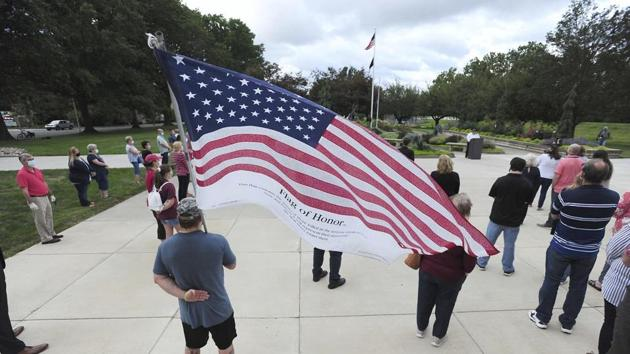 Veteran and Luzerne County employee Dino Ninotti holds a Flag of Honor during a 911 Ceremony Friday.(AP)
