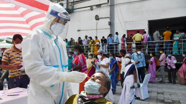 A health worker takes samples for Covid-19 test, in Guwahati on Tuesday.(PTI)