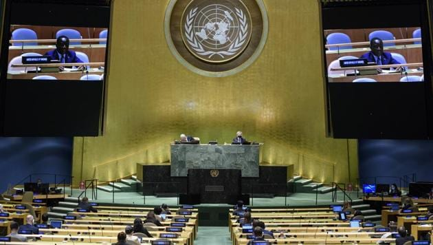 In this UN Photo, Kennedy Gastorn, Permanent Mission of the United Republic of Tanzania to the United Nations, is shown on video monitors as he speaks in person, during the 75th session of the United Nations General Assembly.(AP)