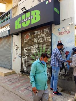 An MC team sealing illegal establishments at Model Town Extension Block A in Ludhiana on Wednesday.(HT Photo)