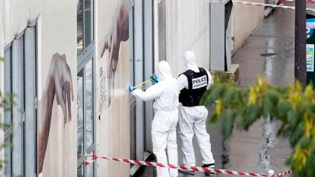 Forensic experts investigate the scene of an incident near the former offices of French magazine Charlie Hebdo, in Paris.(REUTERS)