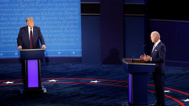 U.S. President Donald Trump and Democratic presidential nominee Joe Biden participate in their first 2020 presidential campaign debate held on the campus of the Cleveland Clinic at Case Western Reserve University in Cleveland, Ohio(REUTERS)