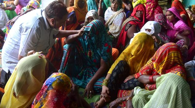 Relatives of the gangrape victim at her village after her death, in Hathras district on Tuesday.(ANI Photo)