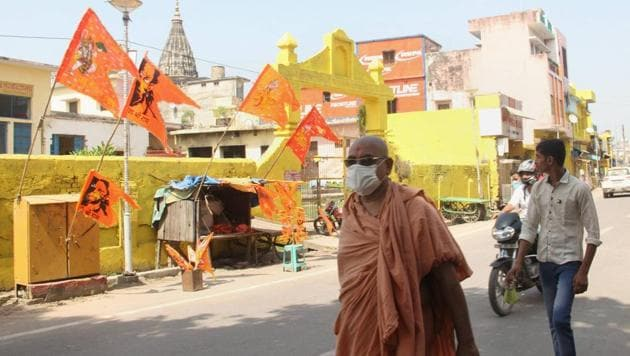 Residents walk past Hanuman Garhi temple, after a special CBI delivered its verdict in the 1992 Babri mosque demolition accused case, in Ayodhya, Wednesday, Sept. 30, 2020.(PTI photo)