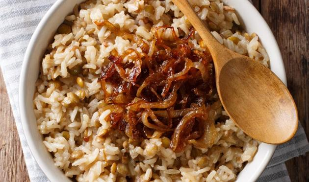 Mujaddara: The preparation of rice, lentils and meat from the Middle East has been around since at least the 13th century.  Think of it as a drier, richer, and more meaty khichdi.  (SHUTTER STOCK)