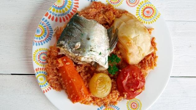 Thieboudienne.  Senegal's national dish (pronounced ceebu-jen) is a combination of marinated smoked fish, a local fermented bean, seasonal vegetables and broken rice.  Served and often eaten on a large communal platter.  (SHUTTER STOCK)
