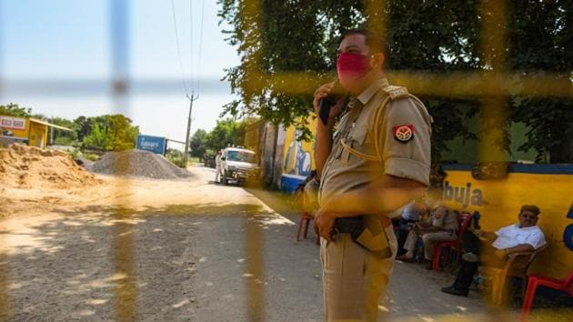 The Hathras administration has deployed scores of police personnel in and around the village of the young Dalit woman who died a fortnight after she was allegedly gang-raped by four so-called upper caste men(HT Photo/Amal KS)
