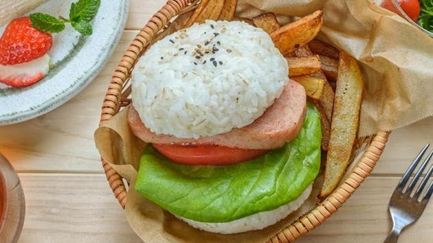 Rice burger.  What does a restaurant do when the Japanese want hambagu (hamburger) but don't eat a lot of bread?  The Mos restaurant chain replaced the bun-shaped rice balls in 1987. An instant success.  (SHUTTER STOCK)