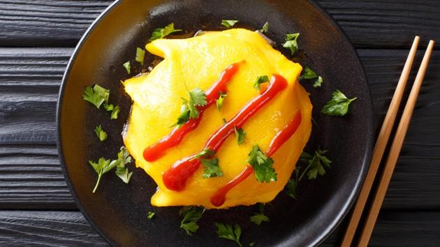 Omurice.  Much more than an omelet and rice, Japan's favorite home dish wraps meat-flavored fried rice in a gooey omelet.  You open the package of eggs, let the soft egg sink into the rice, add ketchup or sauce, and dig.  (SHUTTERSTOCK)