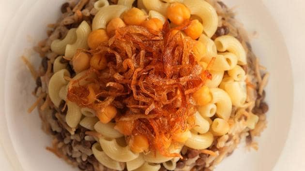 Kushari.  A comforting Egyptian dish of rice, lentils, macaroni and tomato sauce, cooked with spices.  (SHUTTER STOCK)