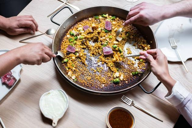 Venetian paella cooked in a wood-fired oven by Michelin-starred chef Quique Dacosta in London.(ArrosQD)