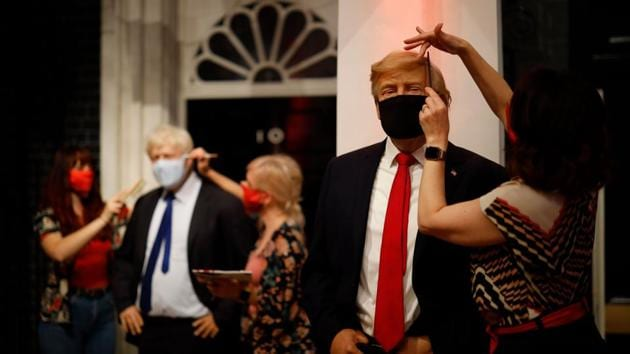 Artists put the finishing touches to wax figures Britain's Prime Minister Boris Johnson and US President Donald Trump as Madame Tussauds prepares to reopen its doors to the public on July 30, 2020.(AFP File)