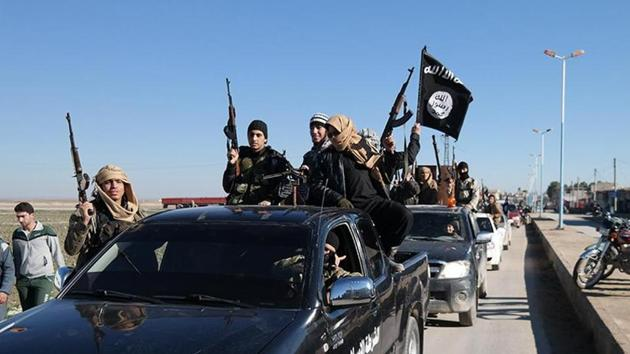 Islamic State's India module Al-Hind made preparations to build a province in jungles of southern Indian states of Karnataka, Tamil Nadu, Andhra Pradesh and Kerala. In this AP file photo from 2015, Islamic State militants pass by a convoy in Tel Abyad, northeast Syria.(AP Photo)