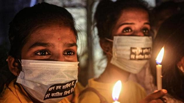 Activists light candles during a protest against the death of a 19-year-old Dalit woman who was allegedly gang-raped in UP's Hathras, in Bhopal.(PTI Photo)