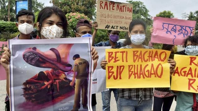 Activists hold placards during a protest over the death of a 19-year-old Dalit woman after an alleged gangrape in UP's Hathras, in Guwahati, Saturday, October 3.(PTI)