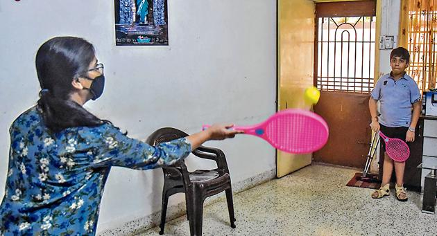 Shreesh Kulkarni, 15, plays with his mother at their home in Kothrud.(Sanket Wankhade/HT PHOTO)
